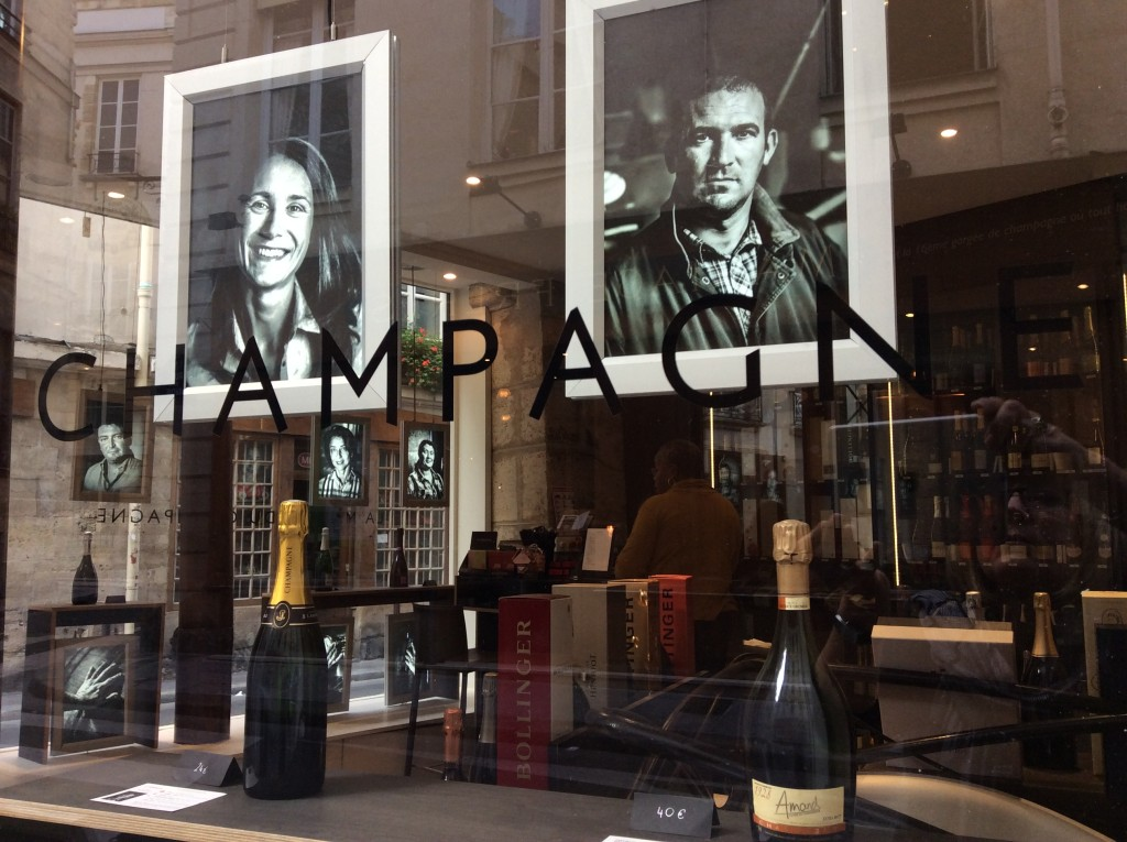 window displaying champagne makers at Dillettantes Maison du Champagne in Paris